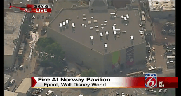 Fire trucks on the scene of a fire at Epcot's Norway Pavilion