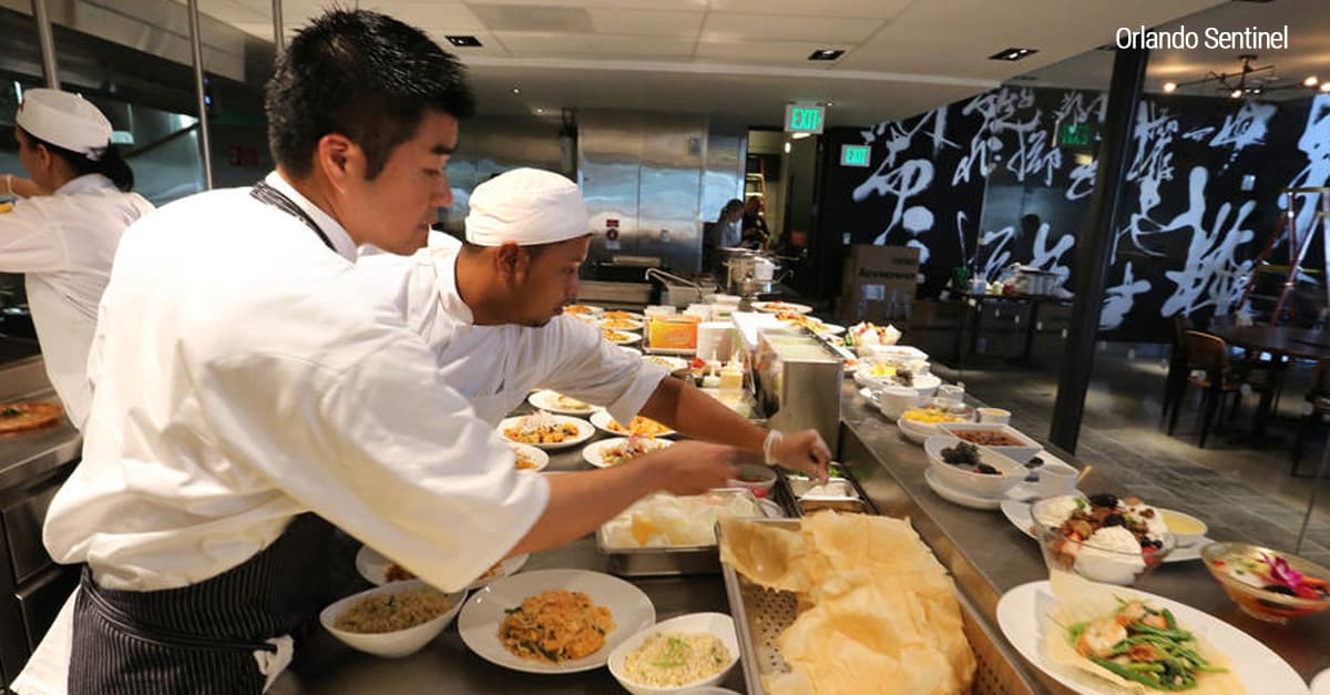 Chefs prepare succulent dishes for guests