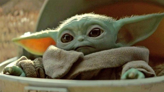 This image has an empty alt attribute; its file name is baby-yoda-mandalorian.jpg